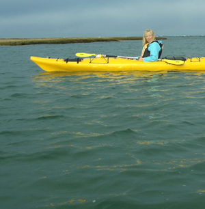 artist PJ Cook kayaking on Cape Cod.