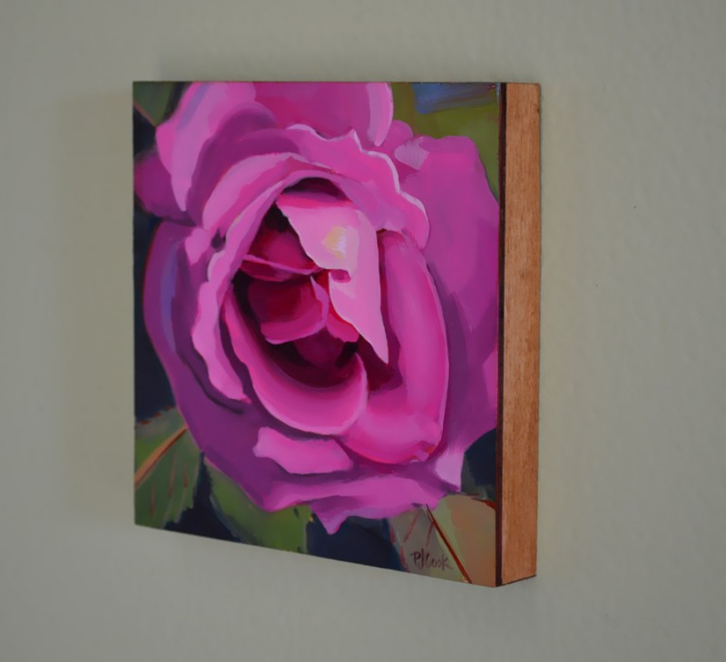 sideview of luscious deep pink rose oil painting on panel by artist PJ Cook